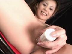Sexy Natsumi nails a vibrator around her snatch