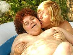 Mature BBWs Frolicking in an Inflatable Pool