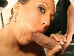 Busty MILF Sucking off a Cock